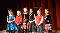 Video: Holy Spirit Catholic School Kindergartners sing Rudolph the Red Nosed Reindeer during the school's Christmas Program