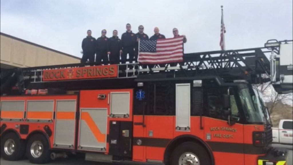 Flag Flown Above Rock Springs Fire Dept in Hands of Olympians
