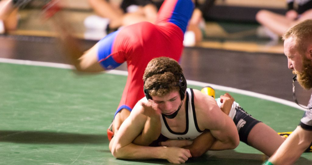 Wolves Beat Evanston in Home Dual, 43-26: Photos