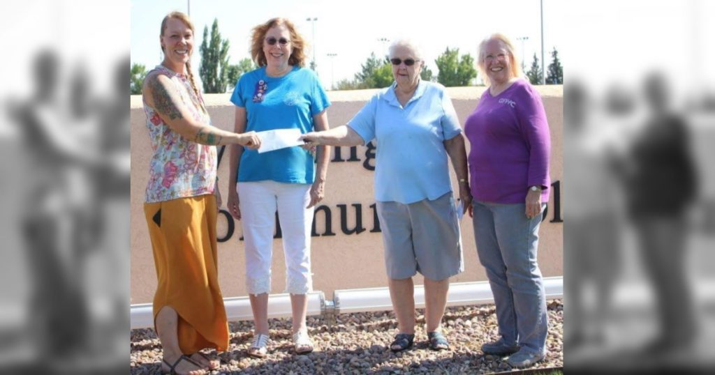 Woman's Club of Rock Springs Presents Grant Checks for College Students