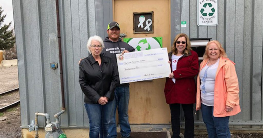 Woman's Club Donates to Recycling Center on Earth Day