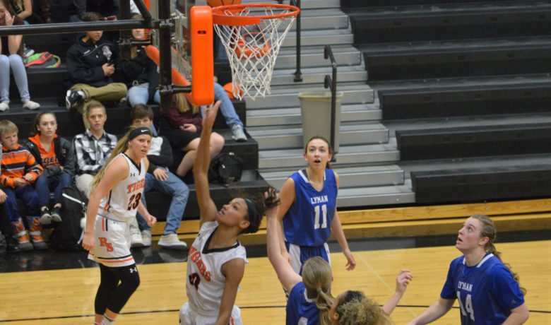 A Freshman Three Keeps the Lady Tigers Perfect